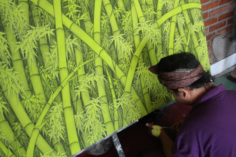 so inspiring to watch balinese artists at work. notice that he is using his hand as a palette