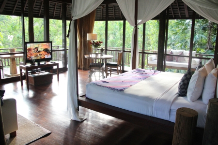 the huge room, with a wrap-around view of the rainforest, is - hands down - honeymooners' dream come true