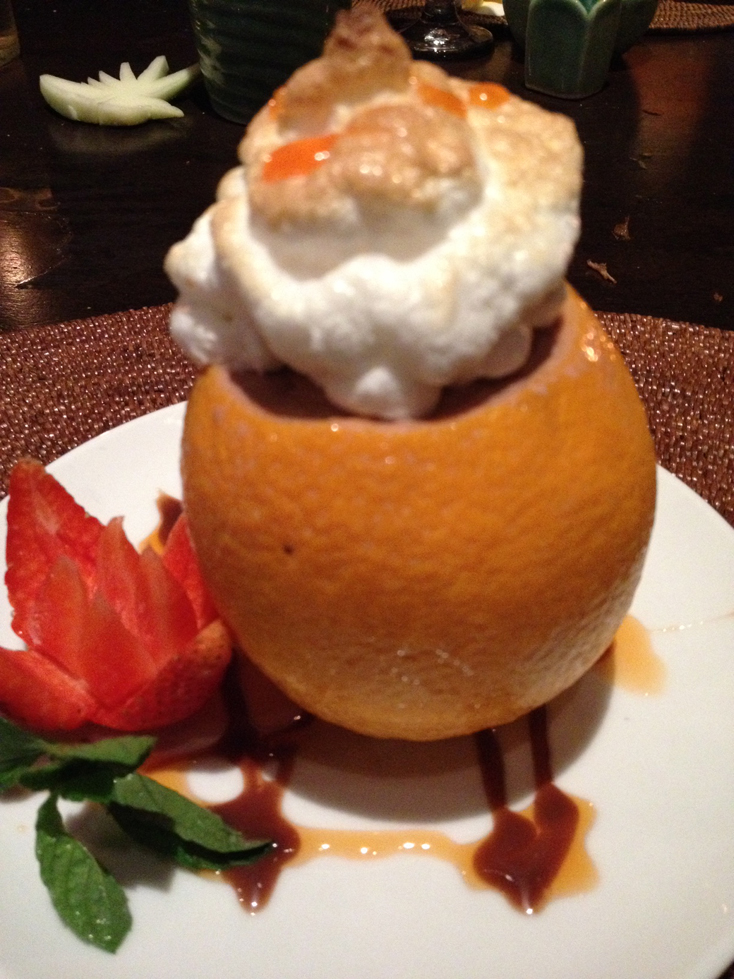 at another dinner at lake leke, an amazing thing happened: isa fell in love... with the dessert - Fried ice cream in an orange shell and topped with meringue )pam's photo)