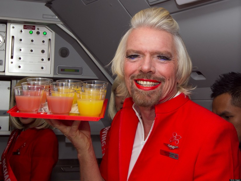 The boss loves to party - here he loses a bet & gamely dons a flight attendant's outfit (Virgin is his airline)