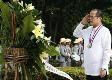 Philippine President Benigno Aquino salutes during a wreath-laying ceremony to commemorate National Heroes Day at the Tomb of Unknown Soldier Monument at Fort Bonifacio